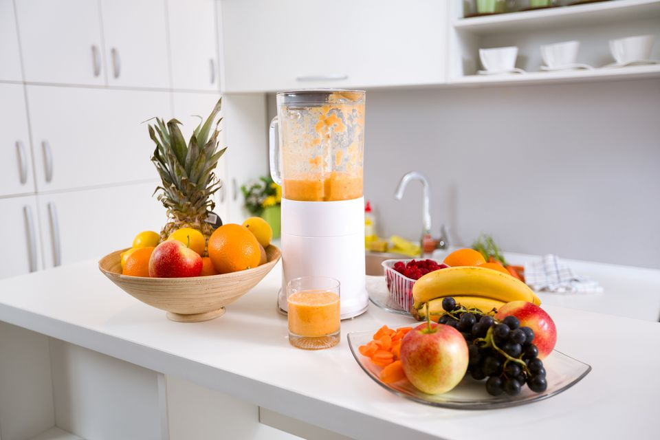 blender and fruit on counter