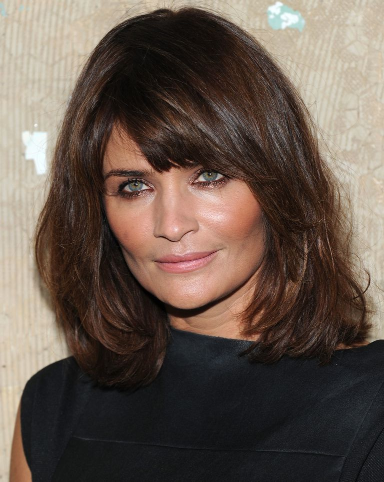 Side swept bangs shoulder length hair for square faces helena christensen ben pruchnie for getty urmus Gallery