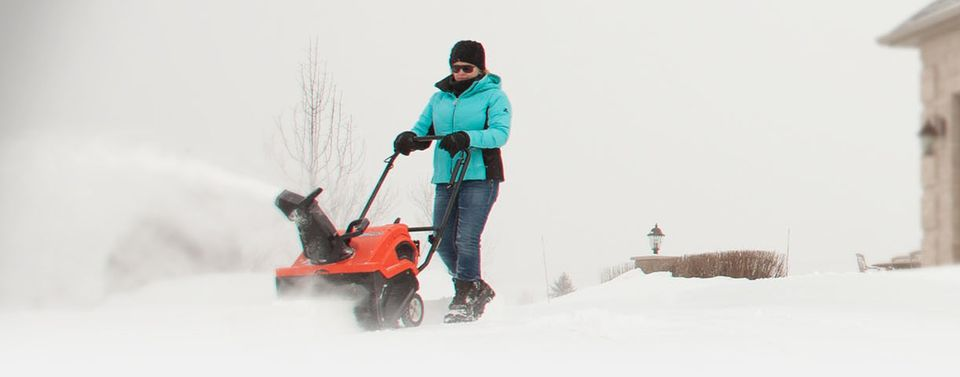 My image shows the Ariens Path Pro snow blower. A woman is using it in a wintry scene.