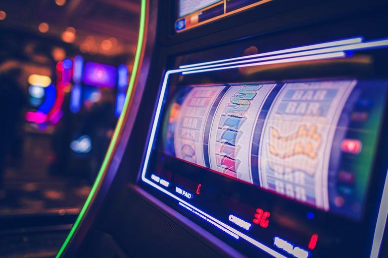 Close-Up Of Illuminated Slot Machine