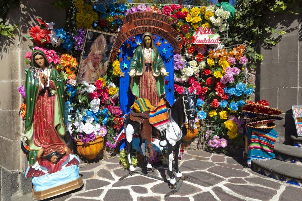 Shrine, statues and flowers