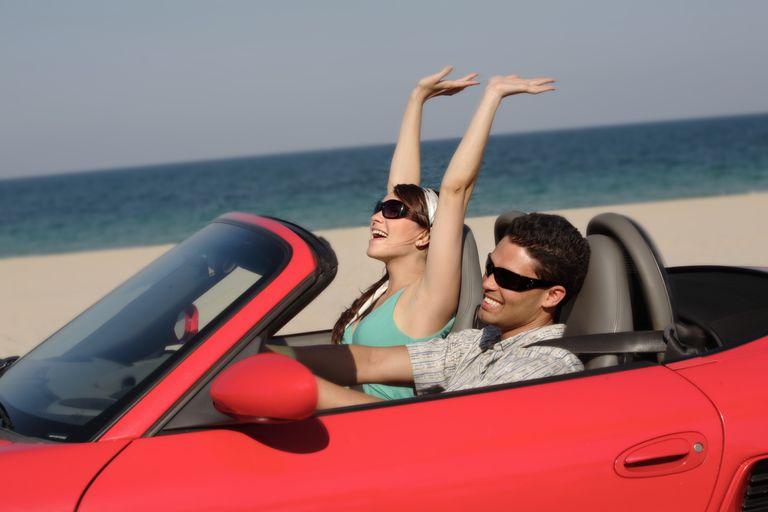 Couple enjoying a convertible ride