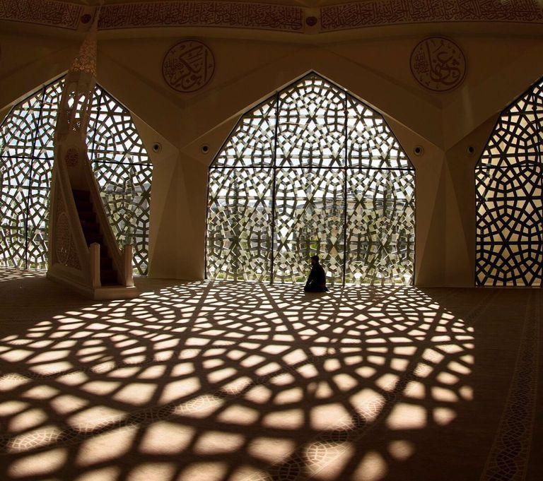 Man Praying in a Mosque