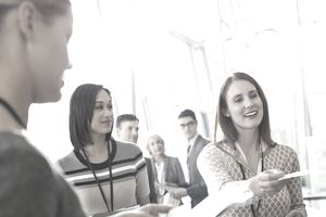 Book publishing conference - Businesswoman handing business cards out