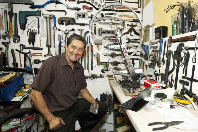 Small business owner sitting in his bike shop.