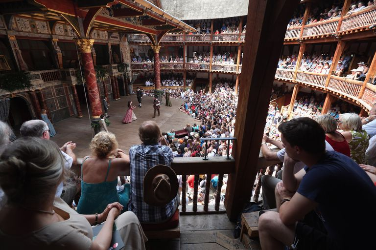 Theatre patrons enjoying performance at the Globe.