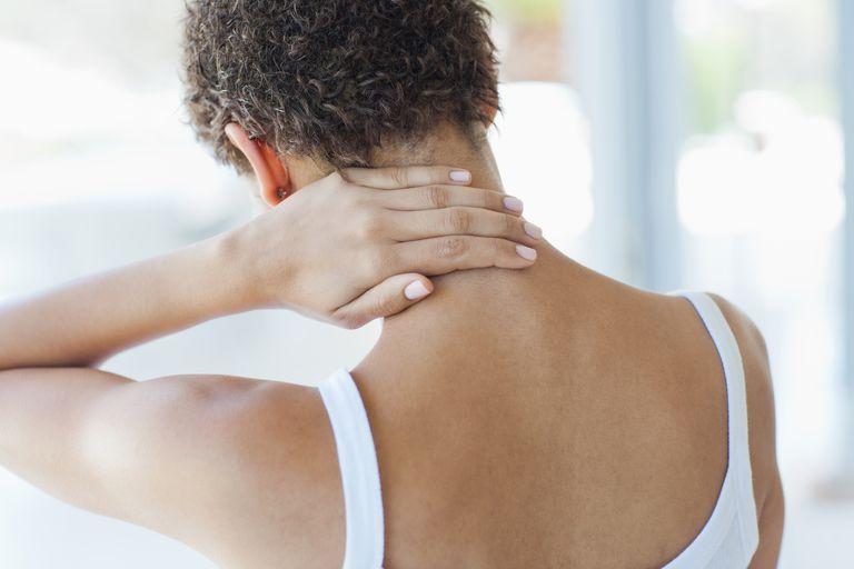 Woman rubbing sore neck