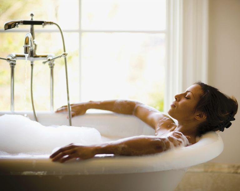 woman relaxing in bubble bath