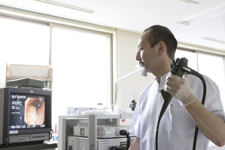 Doctor with endoscope
