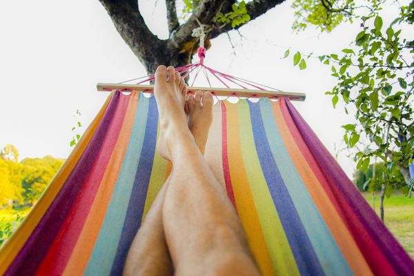 Man resting in colorful hammock