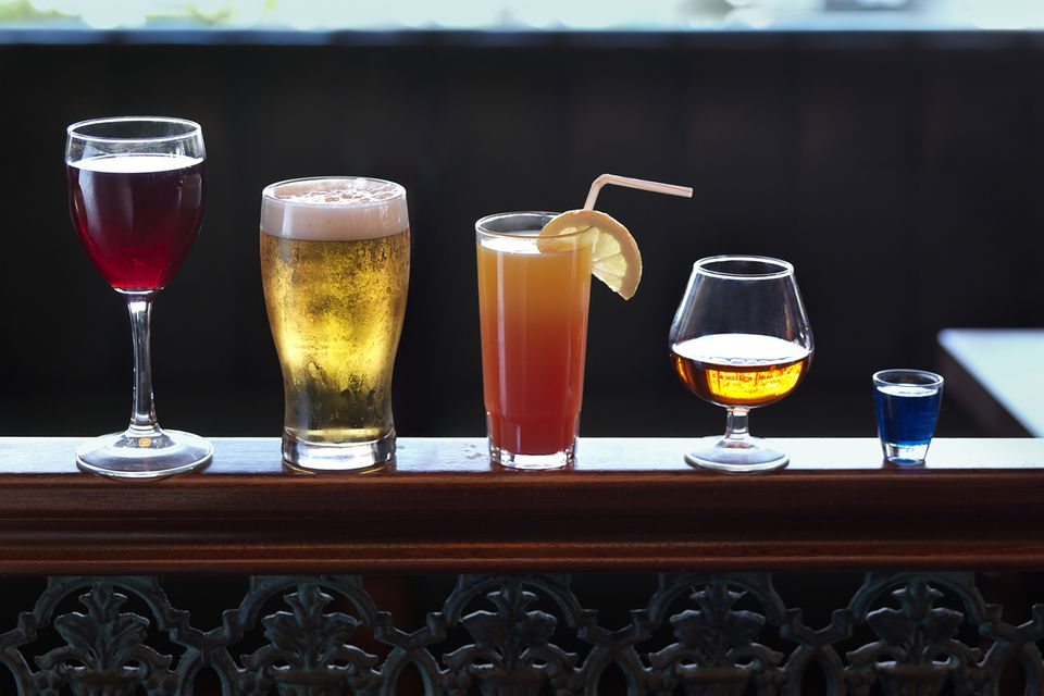 Assorted mixed drinks on the bar.