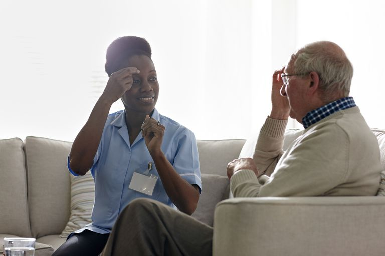 woman translating for patient in doctor's office