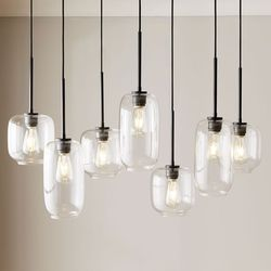 The 8 best chandeliers to buy in 2018 best casual over the table sculptural glass pebble 7 light chandelier aloadofball Image collections