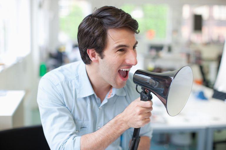 Businessman using megaphone