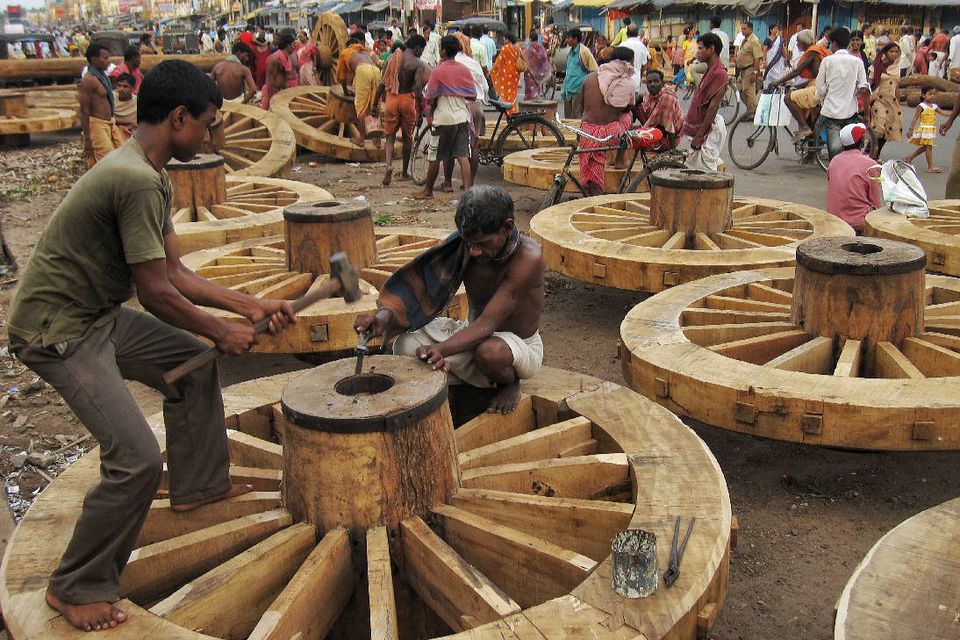 Carpenters in Puri making Rath Yatra chariot wheels.