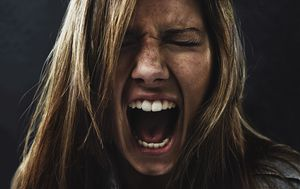 Picture of a woman screaming.