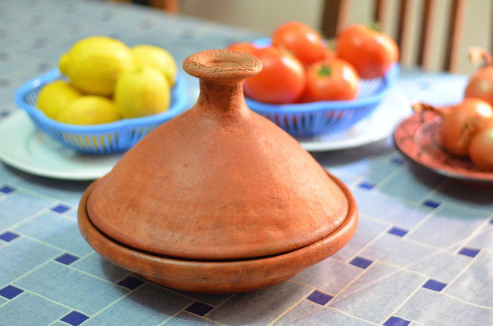 A Moroccan Unglazed Clay Tagine