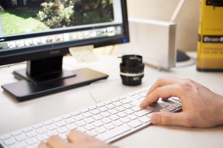 Photographer editing digital Photos
