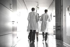 Team of doctors walking in hospital hallway