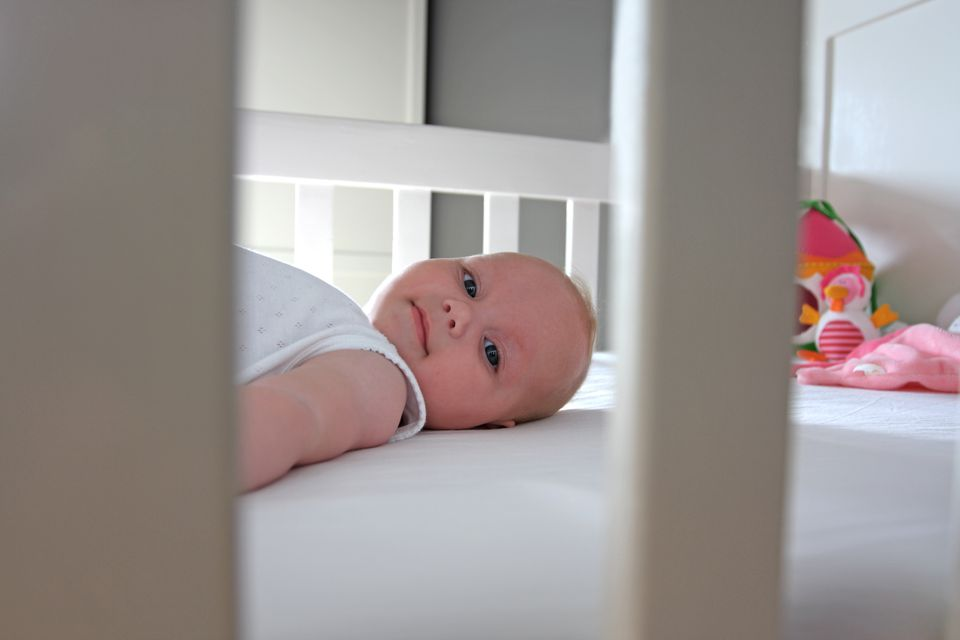 Smiling Baby Girl In Crib
