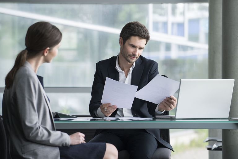 Businessman reviewing documents with client