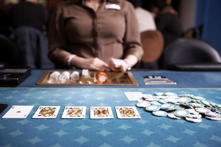 Casino Dealer at Poker table.