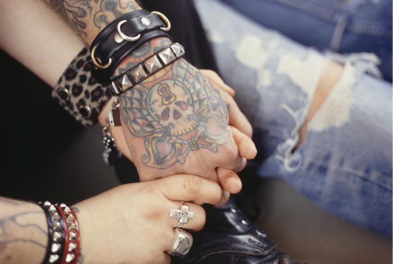 Young Tattooed Couple Holding Hands