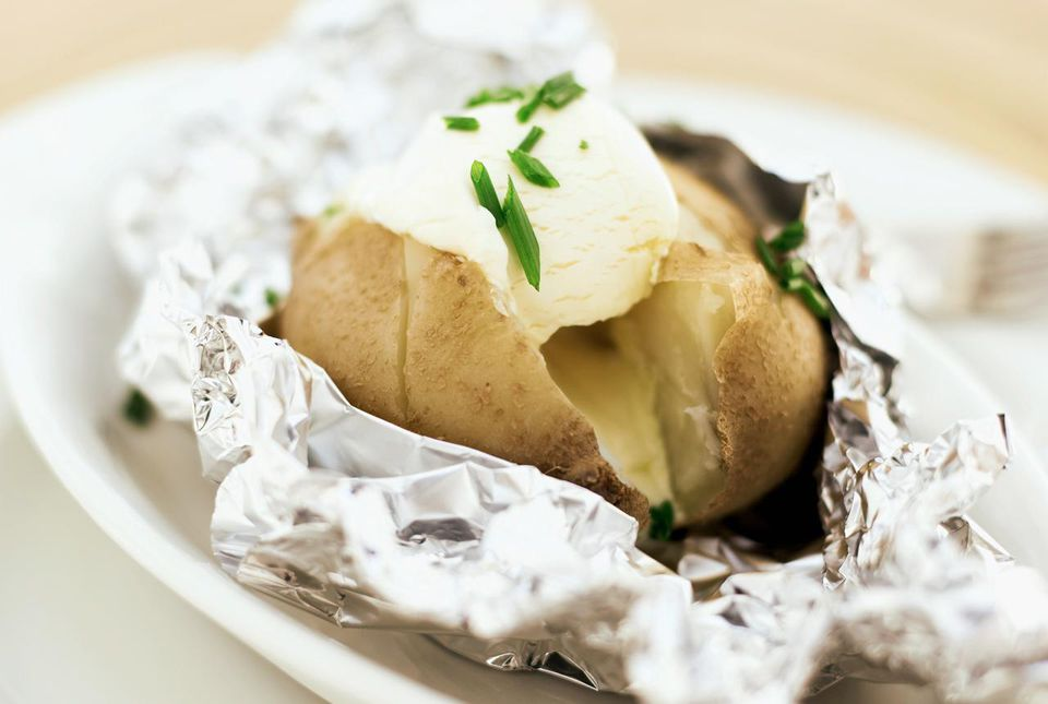 A baked potato with sour cream