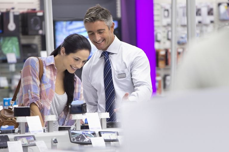 Man and woman at electronics store