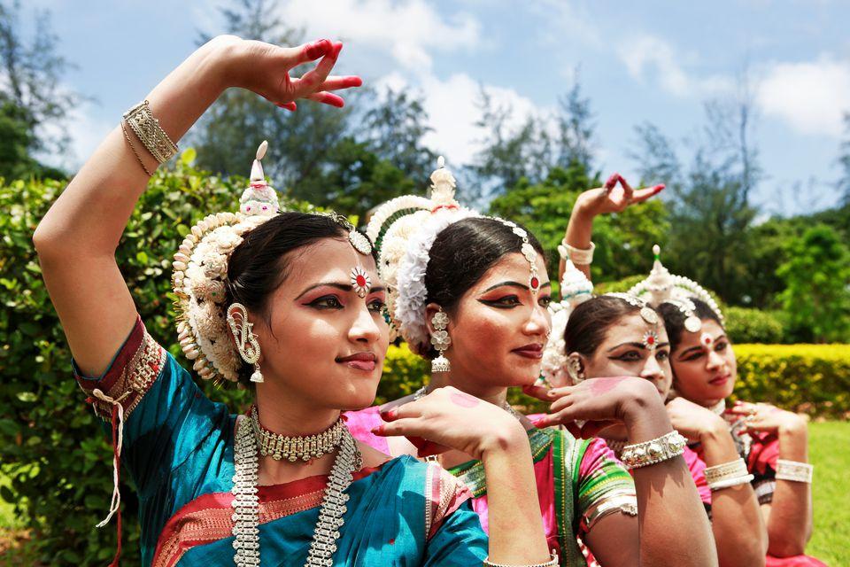 Odissi dancers striking a pose