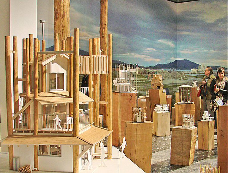 Exhibit room at Venice Biennale 2012, various sized boxes, Japanese model of a communal space structure suspended from poles