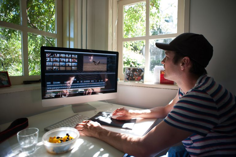 Man editing video clip on computer