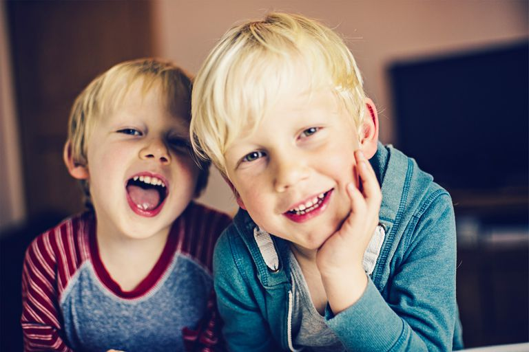 two toddler boys smiling