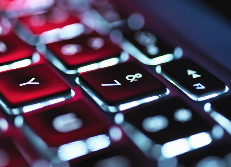 Night-lit laptop computer focusing on the keyboard