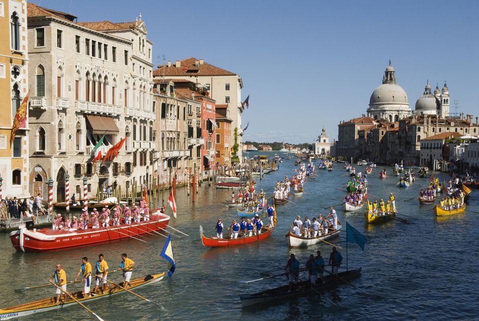 Grand Canal Venice Italy 2009. Regatta Regata Storica procession of boats down the Grand Canal annually first Sunday in September. Church Santa Maria della Salute