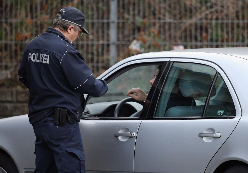Police officer talking to a man in a car
