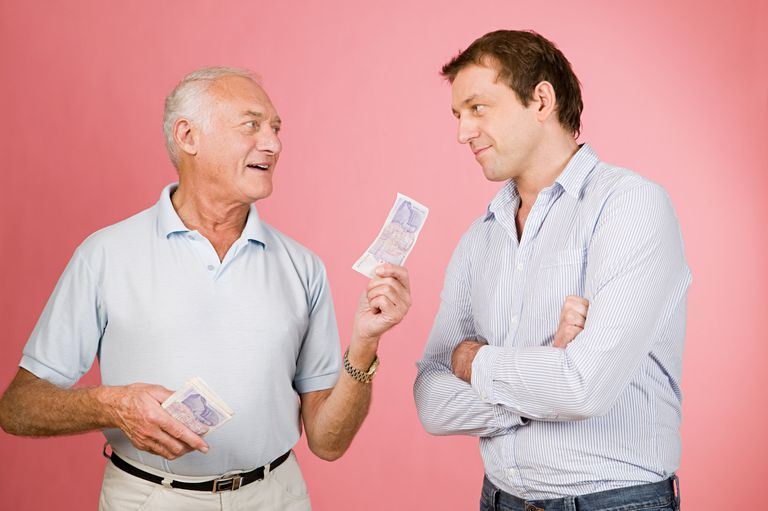 Two men debating whether they should pay off the mortgage now or later.