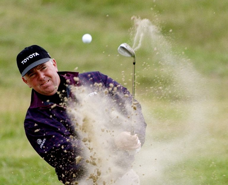 Mark O'Meara blasts out of sand during his victory at the 1998 British Open
