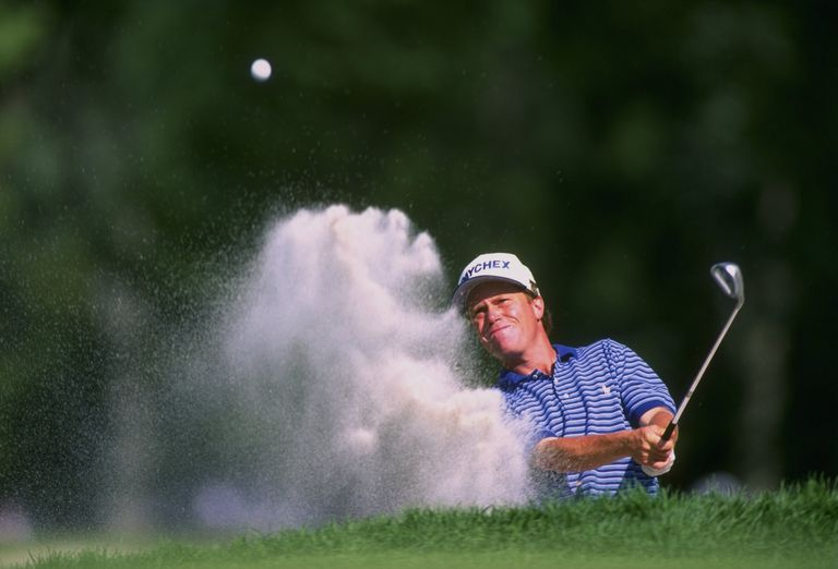 Jeff Sluman blasts a shot out of the sand trap during the 1996 U.S. Open