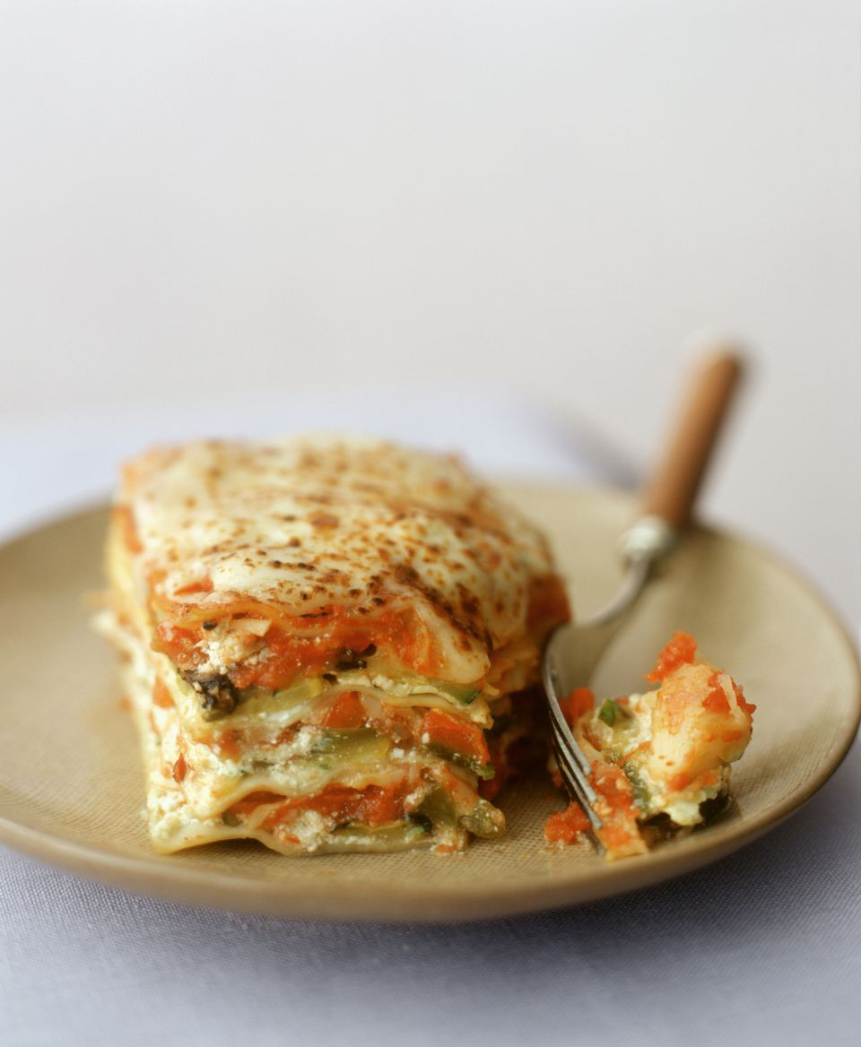 A piece of vegetable lasagne with fork
