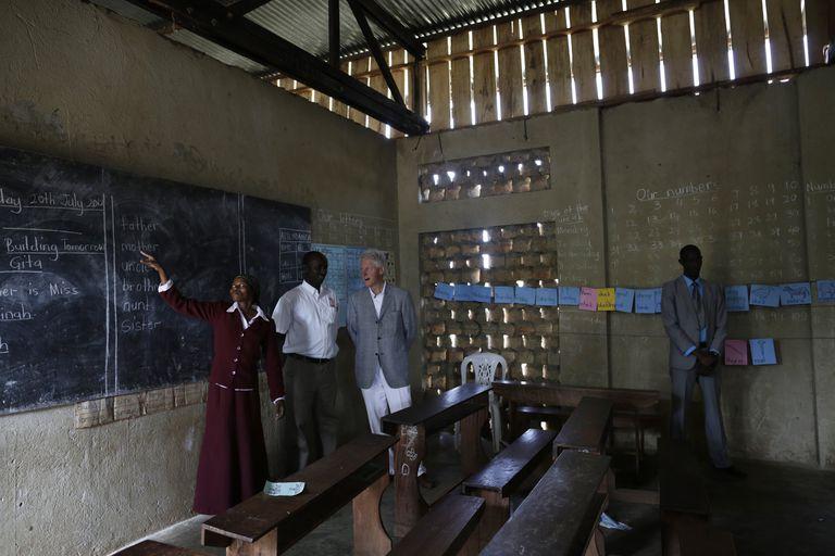sun shines through wall slats inside a school classroom in Uganda