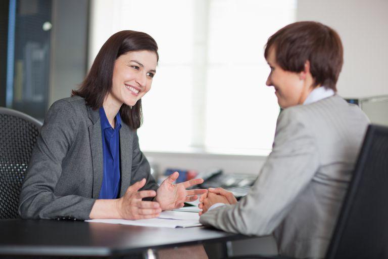 Two businesswomen speaking
