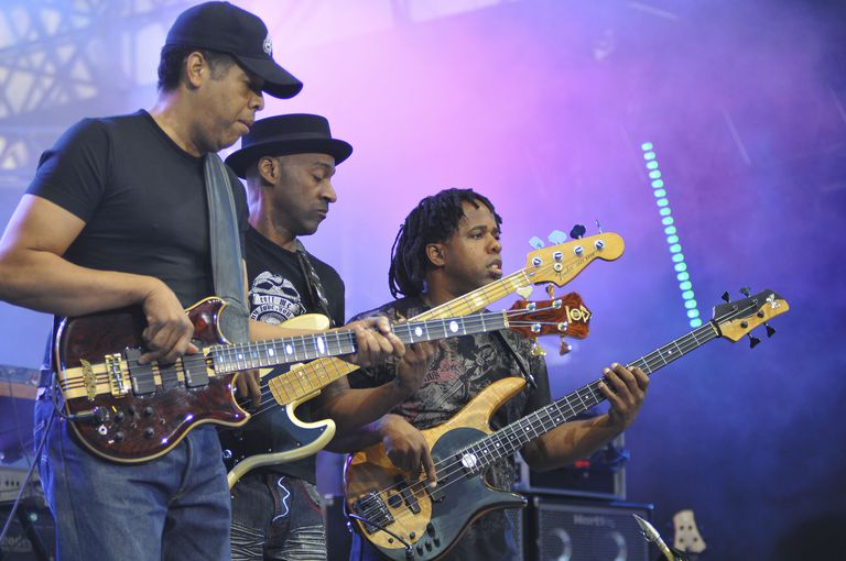 musicians playing on bass guitars