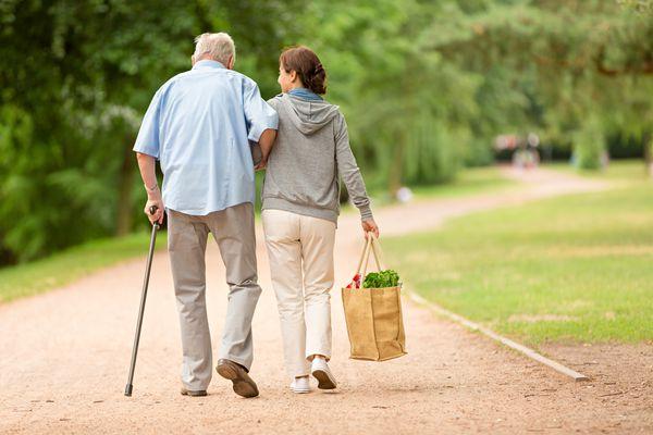 Caregiver – woman helping senior man with shopping