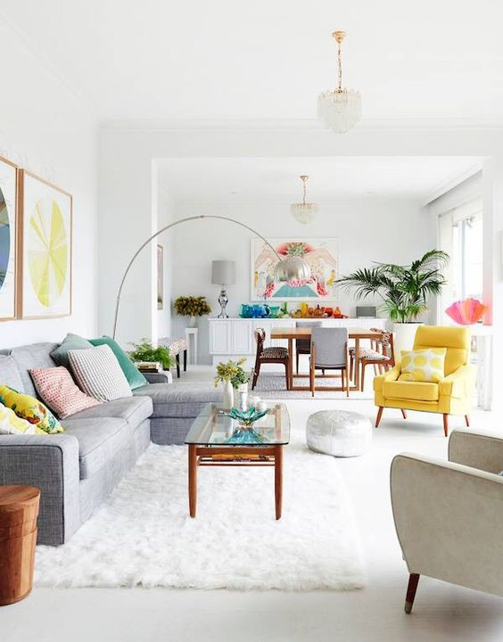 A colorful living room dining room combo