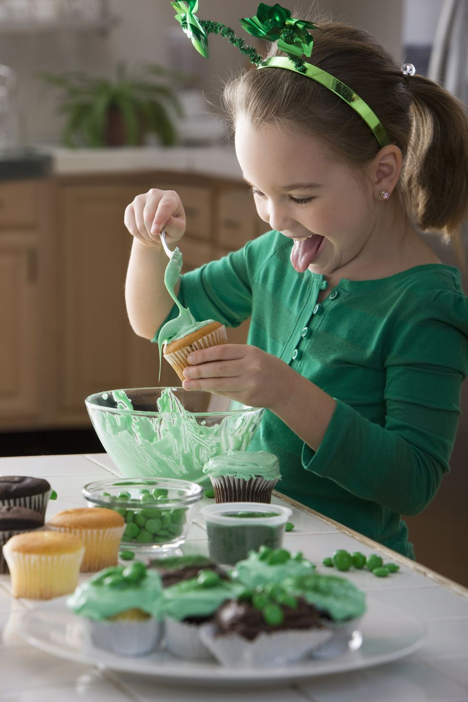 girl making St. Patrick's day cupcakes
