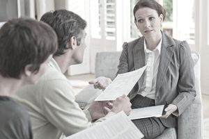 A loan advisor meets with couple to discuss loan options