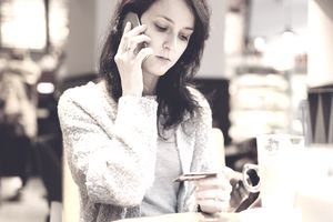 Woman frustrated calling company about credit card
