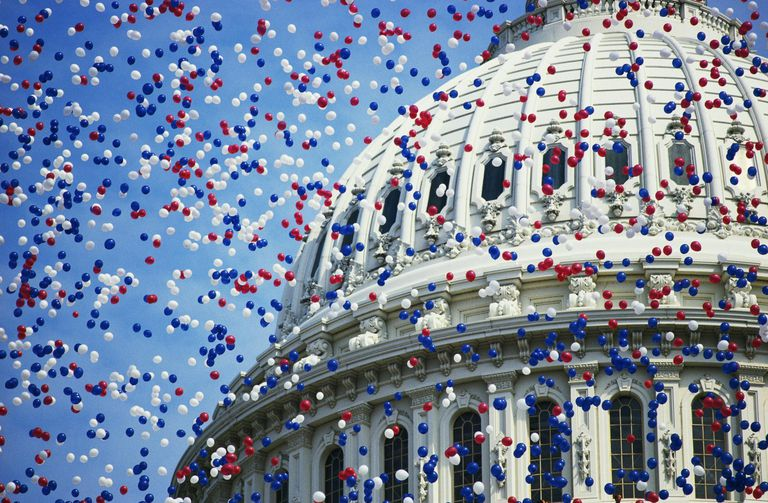 This is the U.S. Capitol during the Bicentennial of the Constitution Celebration. There are red, white and blue balloons falling around the Capitol Dome. It marks the dates that commemorate the Centennial 1787-1987.'