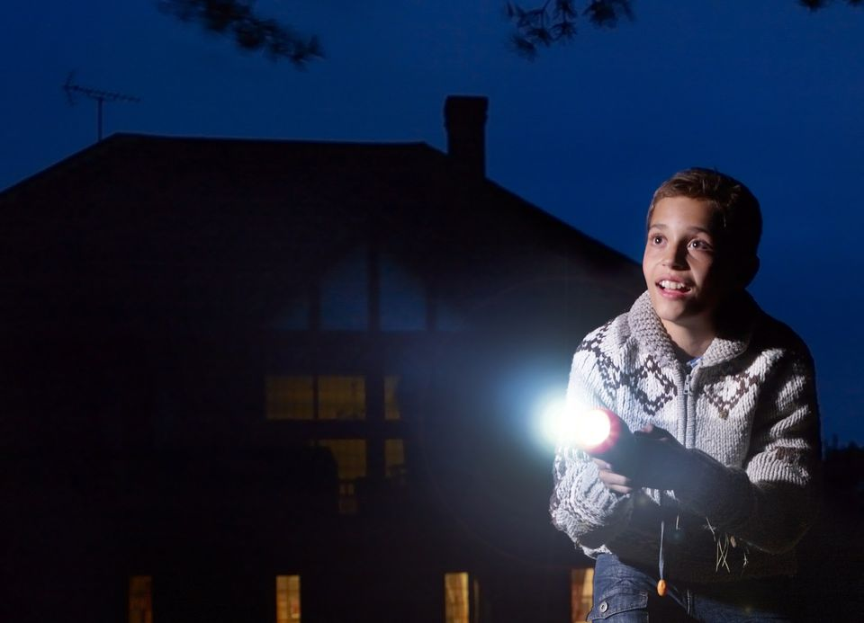 A picture of a boy with a flashlight